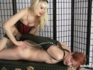 Long blonde haired domina...