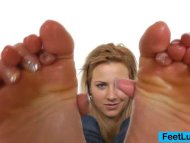 Blonde shows off bare feet
