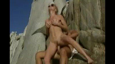 Desolated beach sex in retro porno