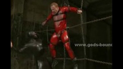 Gay slave and master dressed in leather fucking in bondage punish