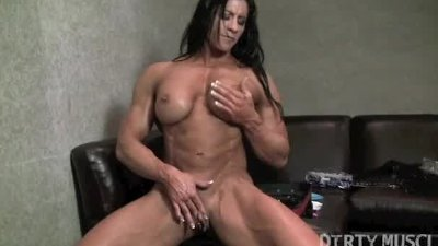 Muscular Brunette Plays With Clit