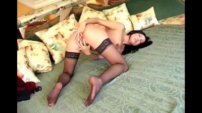 Brunette fingering in panties and sheer stockings