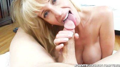 Hot MILF Olivia Parrish tit fucks and sucks in POV