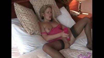 Sexy UK pornstar Kaz B didlos her pussy
