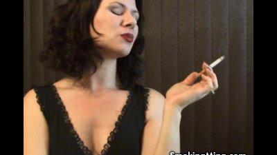 MILF Mina puffs on a cigarette