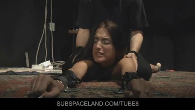 Redhead babe gets her ass paddled in bondage