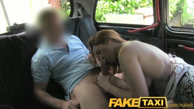 FakeTaxi Cheeky red head pays with a blowjob