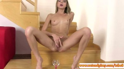 Pee fetish babe playing with speculum