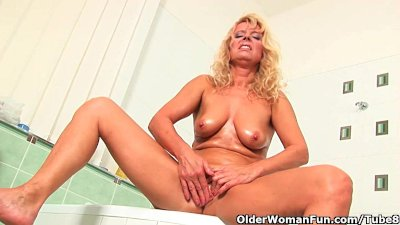 Granny masturbates in bathroom