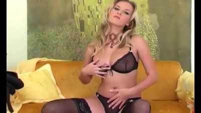 Pretty blonde fingering in thigh high stockings