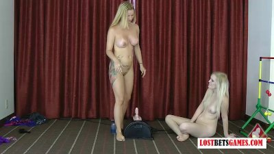 Two blondes play a strip game of