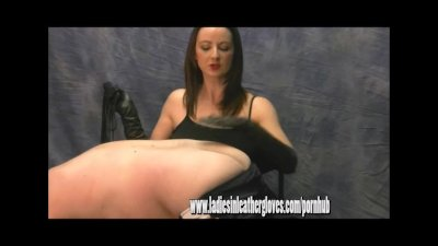 Hot dominant mistress gives slave dog leather glove spanking and whipping
