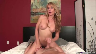 Naughty milf with big tits handjob